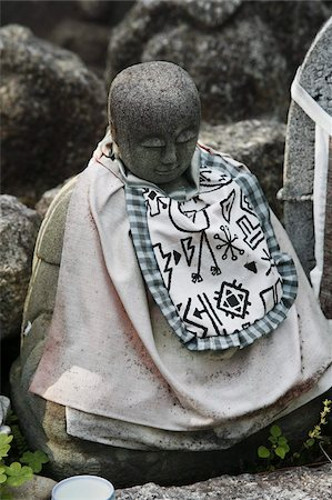 841-03675826 © robertharding / Masterfile Model Release: No Property Release: No Jizo is a Shinto god who looks after dead children's souls, Kyoto, Japan, Asia